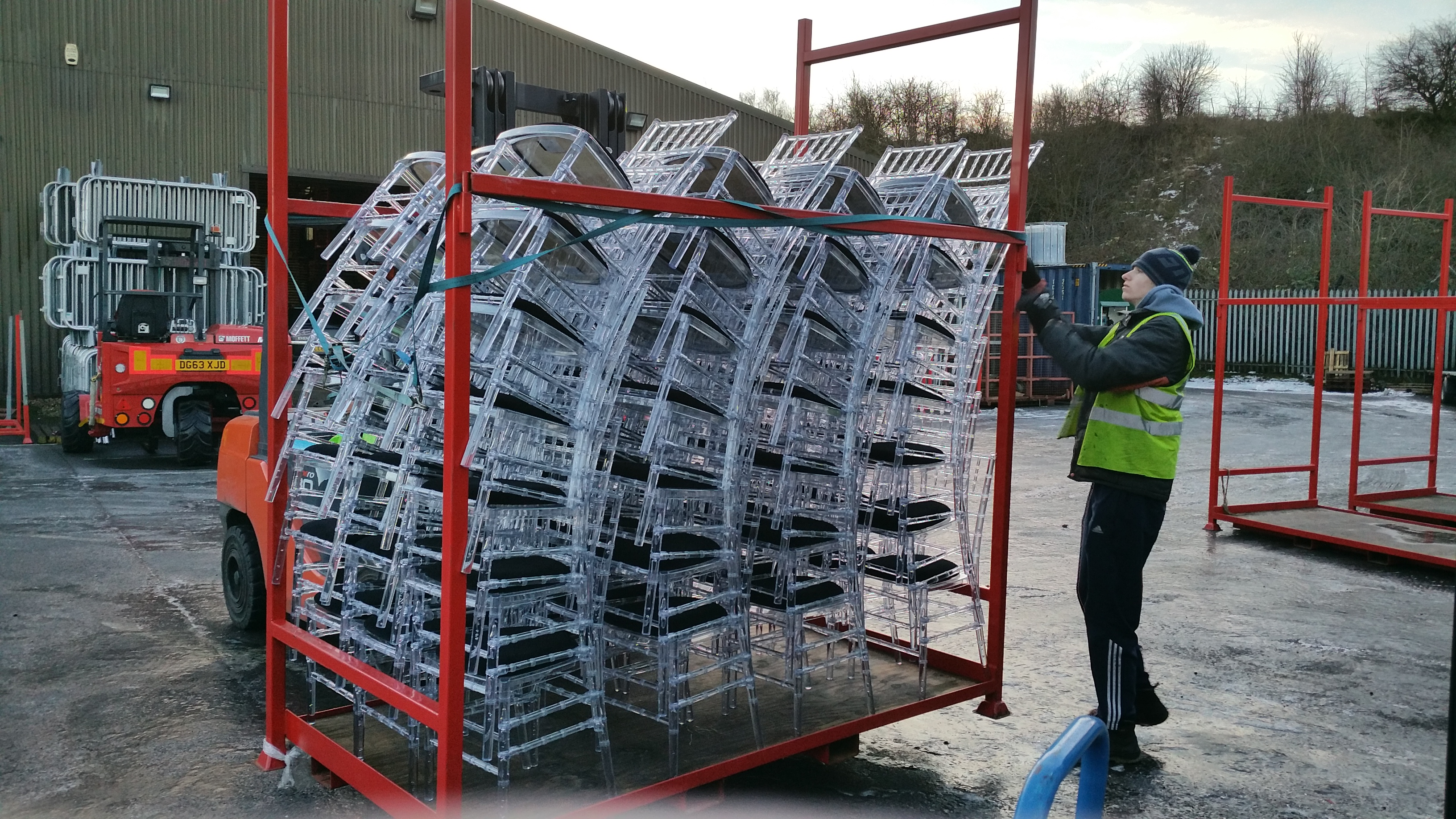 Ice Chiavari Chairs being loaded for transport to event - BE Event Hire