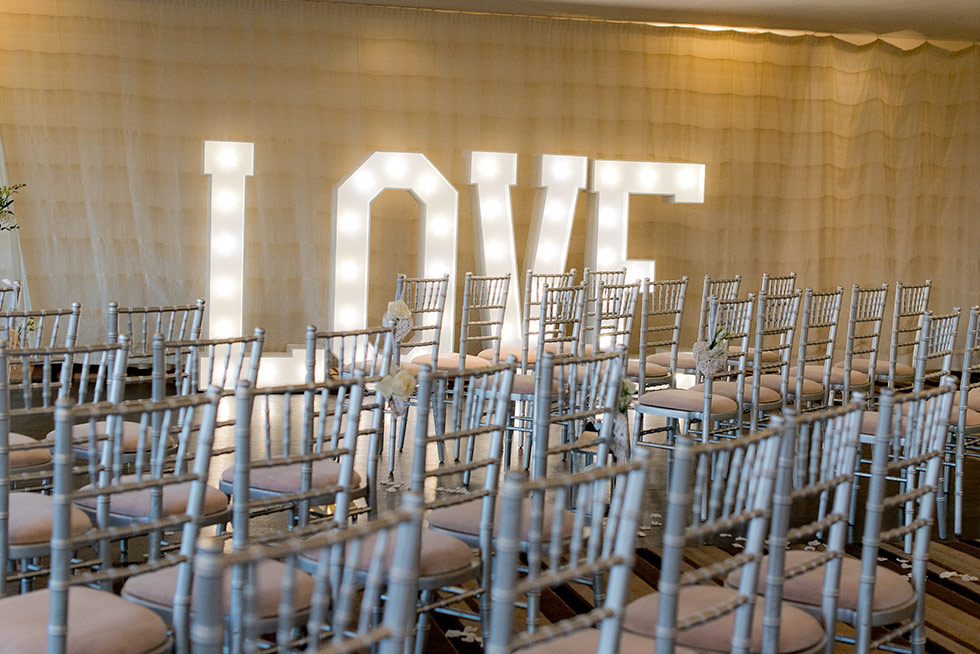 Silver Chiavari Chairs layed out for wedding ceremony - BE Event Hire