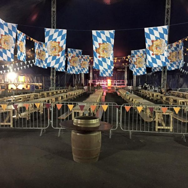 benches and trestle tables at use at an Ocktoberfest beer festival - BE Event Hire